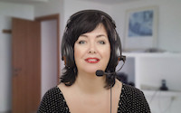 Black haired woman in headphones is learning how to sound like a native English (or any) speaker in online language lesson